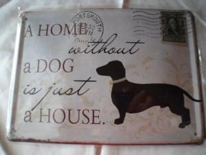 Reproduction tin sign with daschund dog